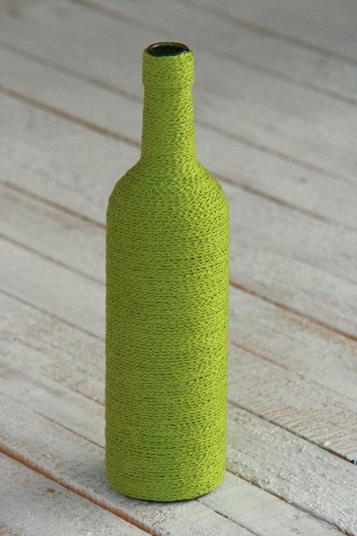 Pudeles ar tamborētu auklu